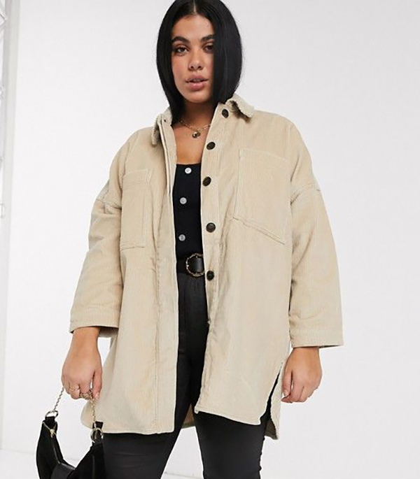 A plus-size model wearing a corduroy shacket.