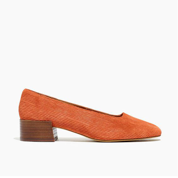 A rust-orange corduroy block heel shoe.