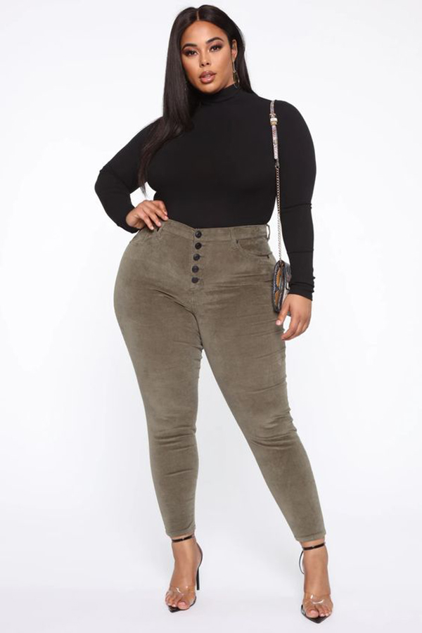 A plus-size model wearing corduroy pants.