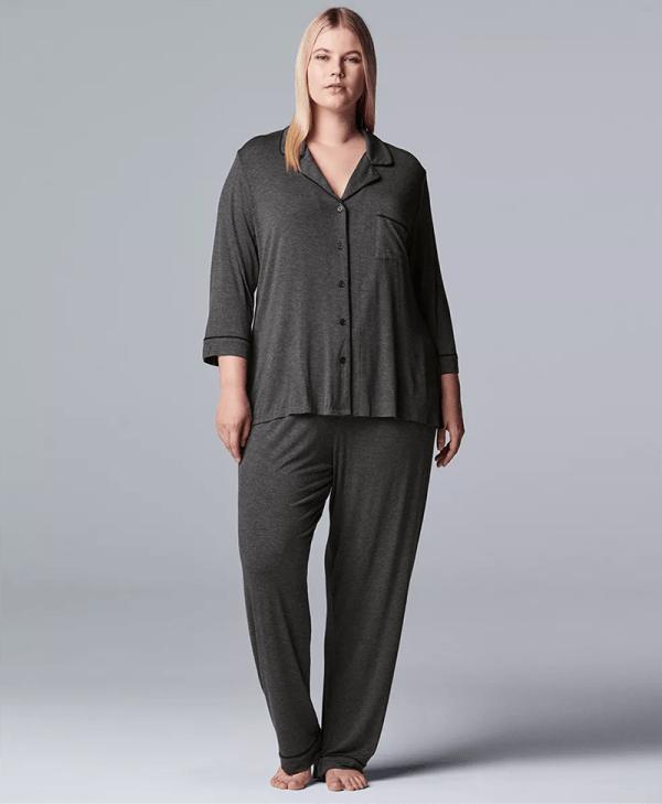 A plus-size model wearing a charcoal pajama set.