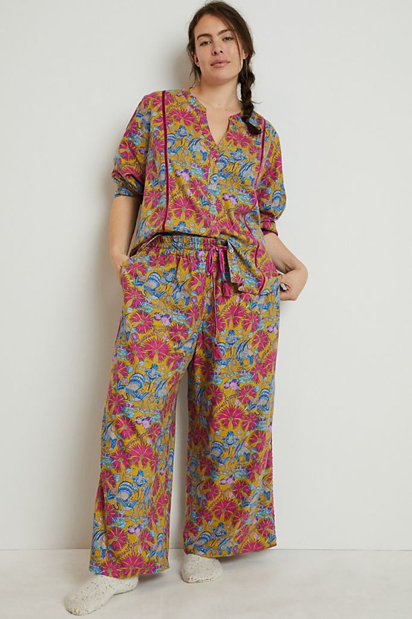 A plus-size model wearing a printed pajama set.
