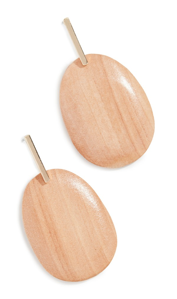 Drop earrings crafted from large, somewhat flat wooden beads