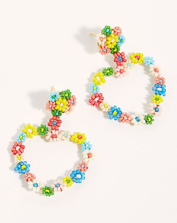 Heart-shaped hoop earrings covered in beaded flowers