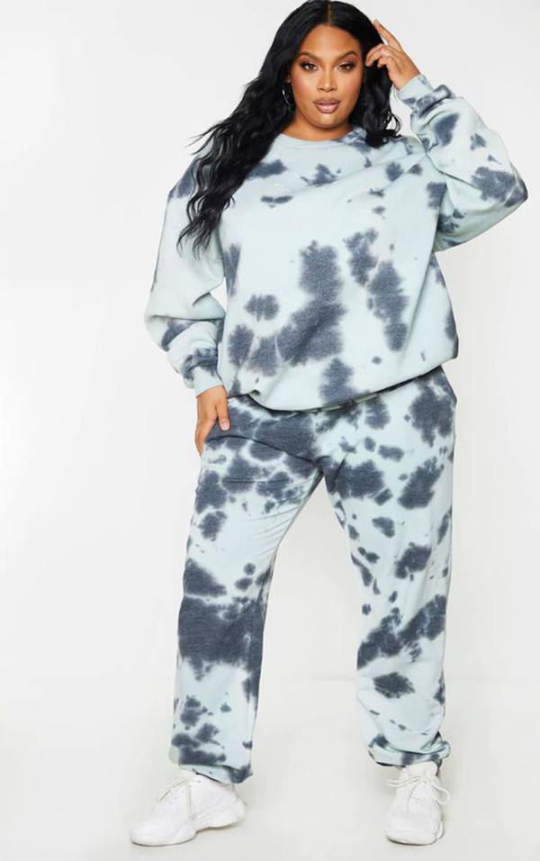 A model wearing a blue plus-size tie-dye loungewear set.
