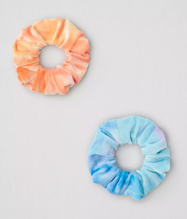 An orange tie-dye scrunchie and a blue tie-dye scrunchie.