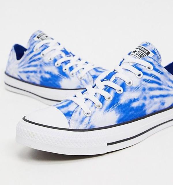 A pair of blue tie-dye sneakers.