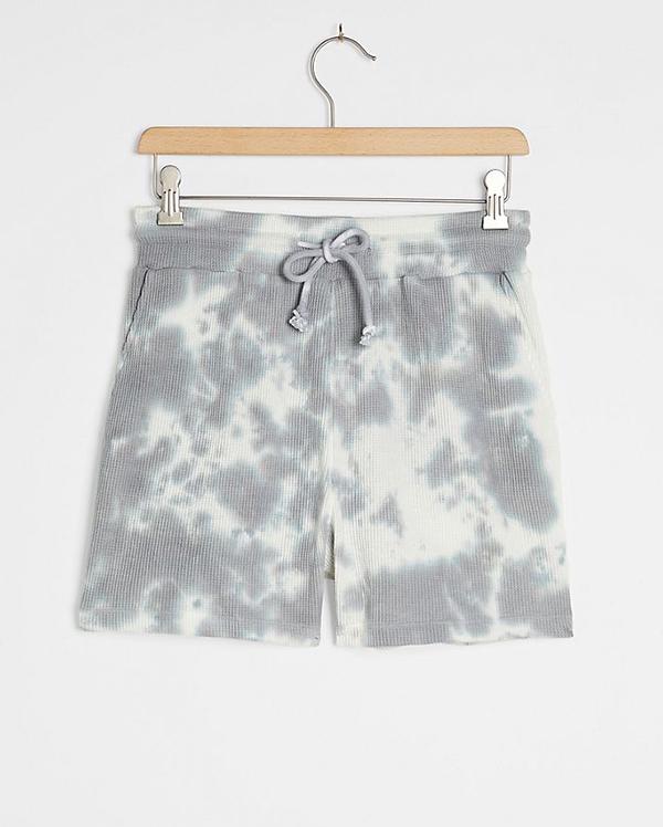 A pair of plus-size tie-dye shorts.