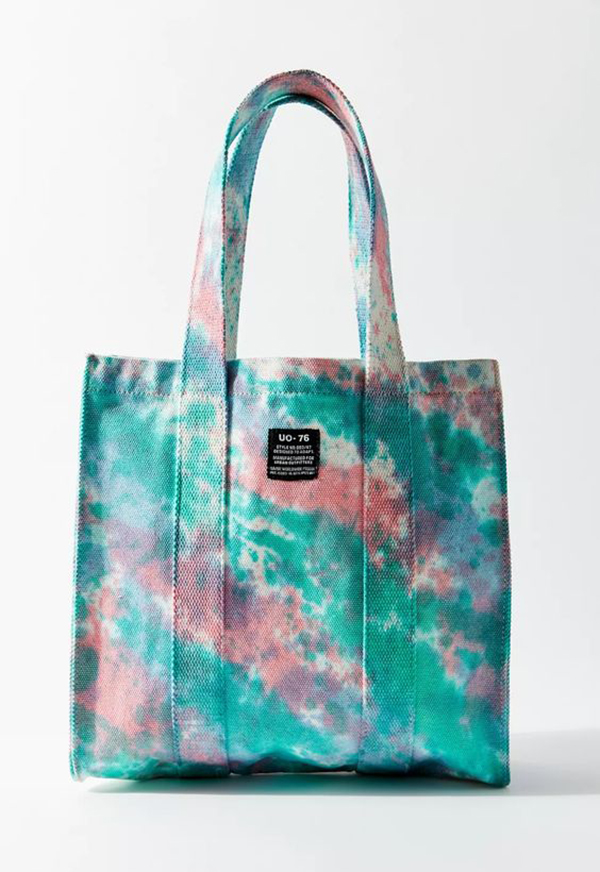 A green and pink tie-dye handbag.