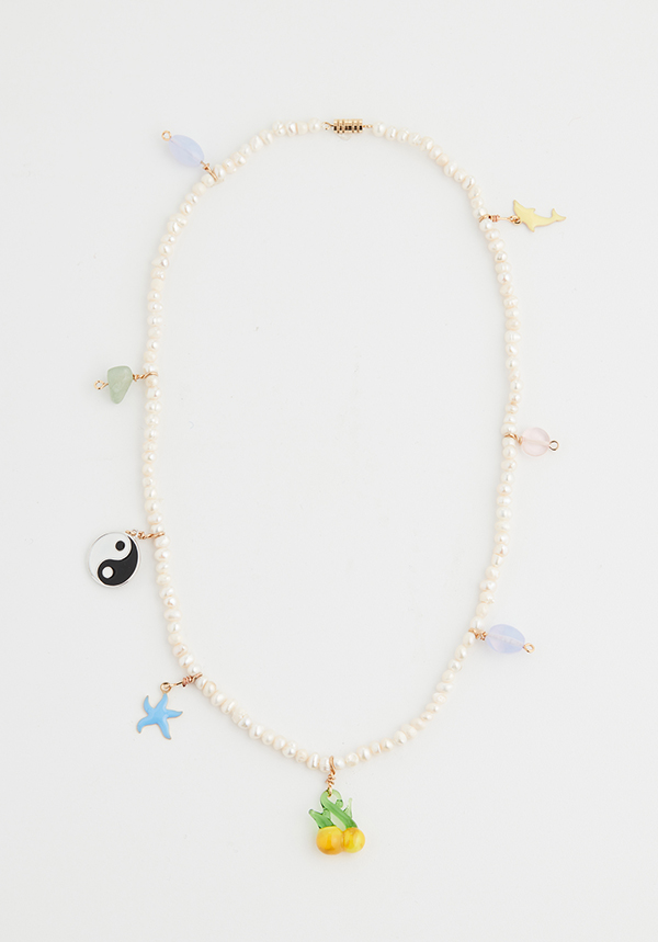 Pearl necklace with charms.