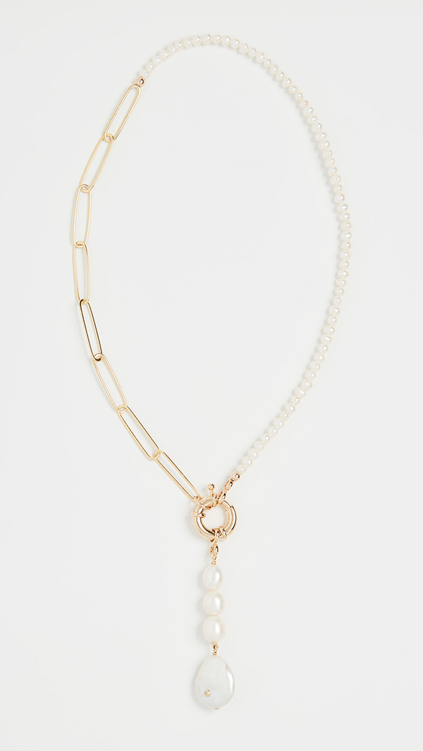 A necklace that's half made from a loose gold chain and half made from a strand of pearls.