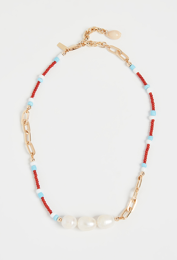 A red and blue beaded necklace with a line of pearls on it.