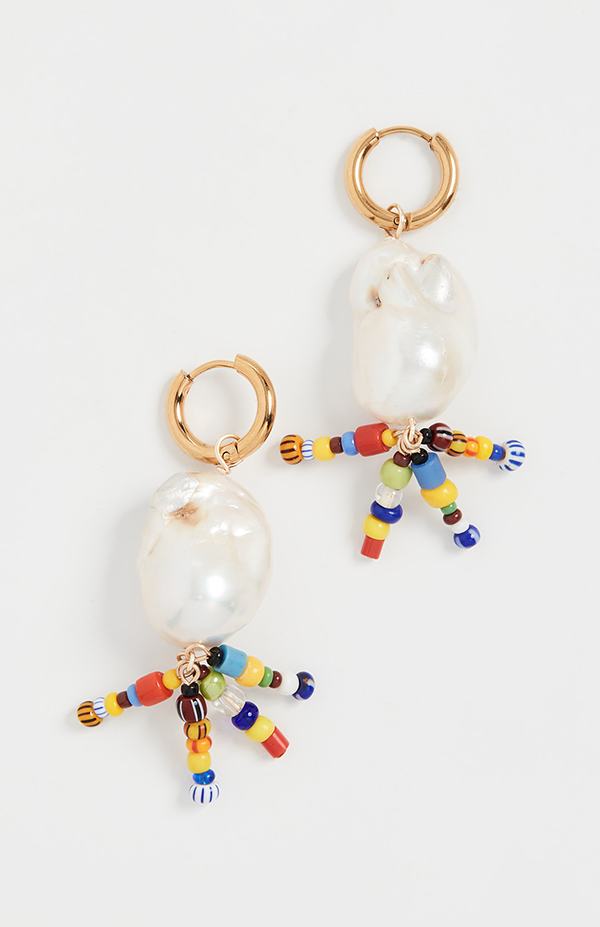 A pair of pearl drop earrings with chains of rainbow beads dangling from them.