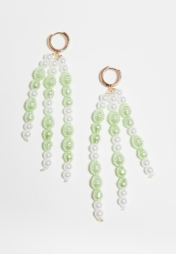 Drop earrings with strings of green and white pearls.