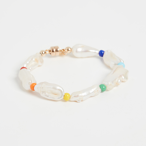 A pearl bracelet punctuated by rainbow beads.