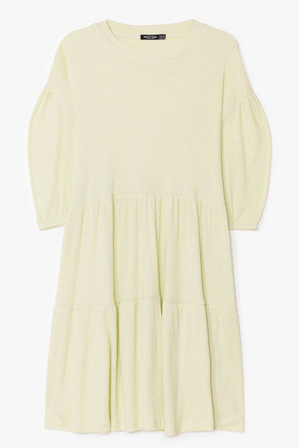 A plus-size pale yellow babydoll dress.