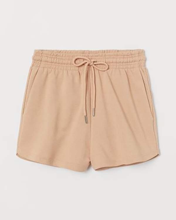 A pair of nude plus-size sweat shorts.
