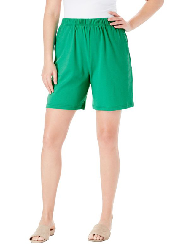 A model wearing green sweat shorts.