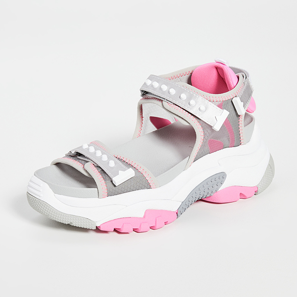 A pink, velcro-strapped sneaker sandal.