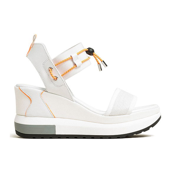 A white sneaker sandal wedge.