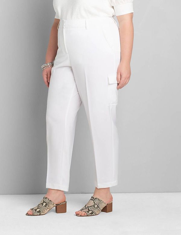 A model wearing a pair of plus-size cargo pants in white.