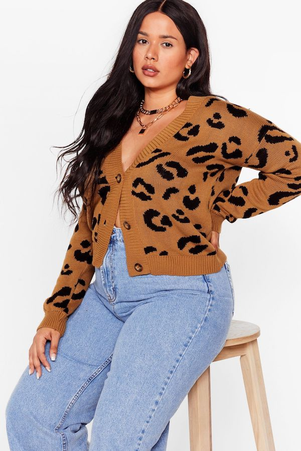 A woman wearing a plus-size leopard print cardigan.