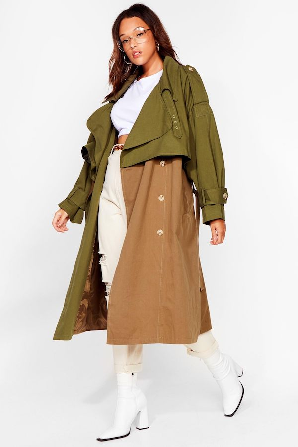 A woman wearing a plus-size green and brown color-blocked trench coat.