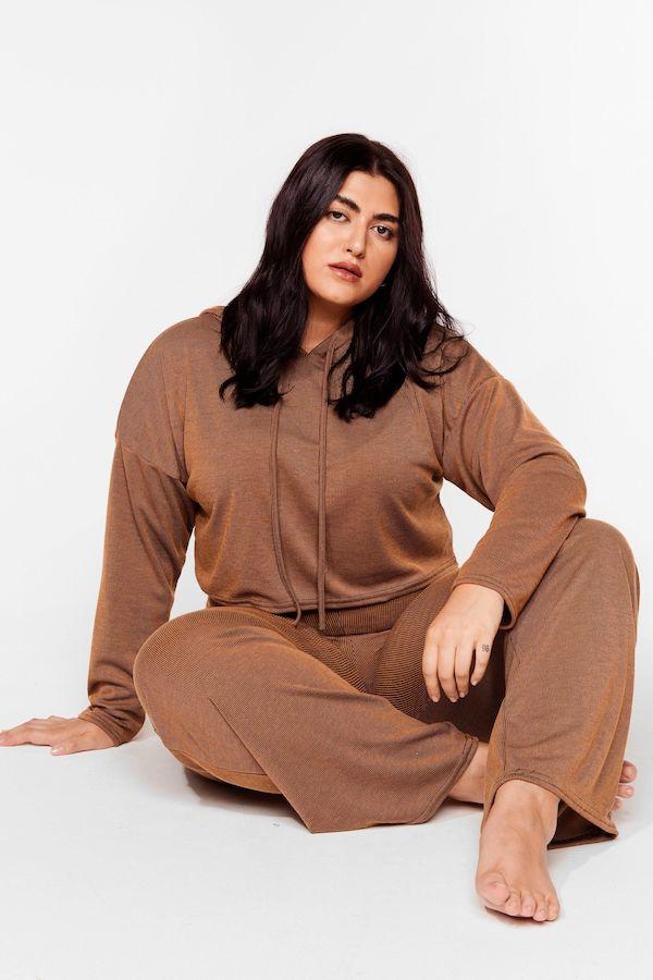 A woman wearing a dark brown loungewear set.