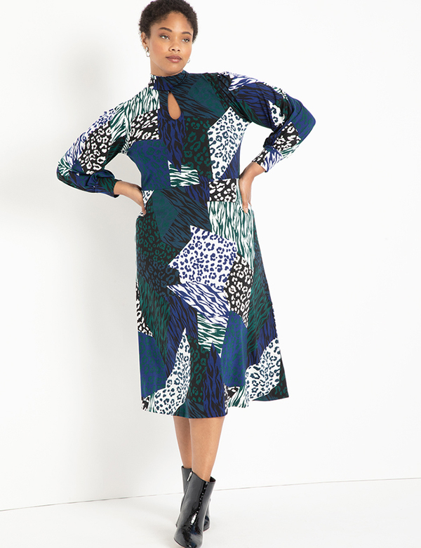 A plus-size model wearing a printed dress, which is now on sale at Eloquii for less than $39.