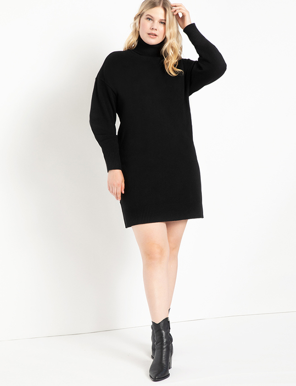 A plus-size model wearing a black sweater dress, which is now on sale at Eloquii for less than $39.