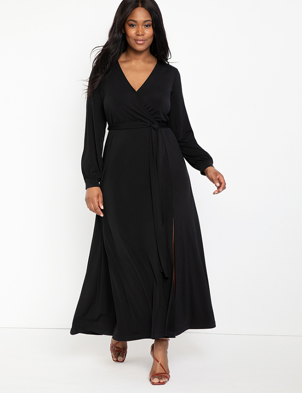 A plus-size model wearing a black wrap maxi dress, which is now on sale at Eloquii for less than $49.