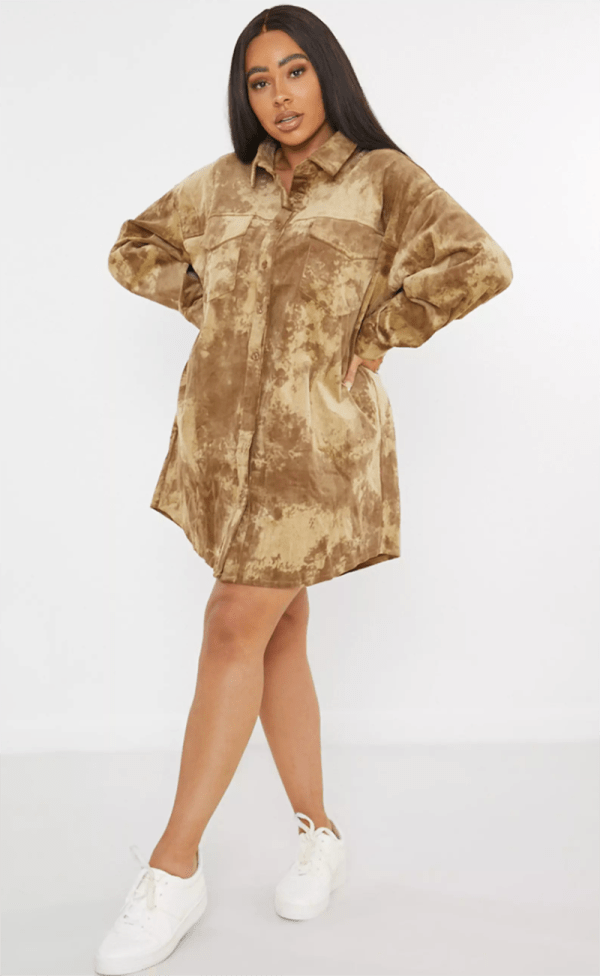 A plus-size model wearing a brown tie-dye corduroy shirtdress.