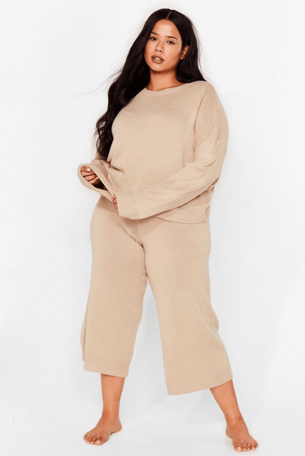 A plus-size model wearing a tan lounge set.