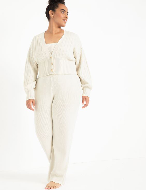 A plus-size model wearing a white lounge set.