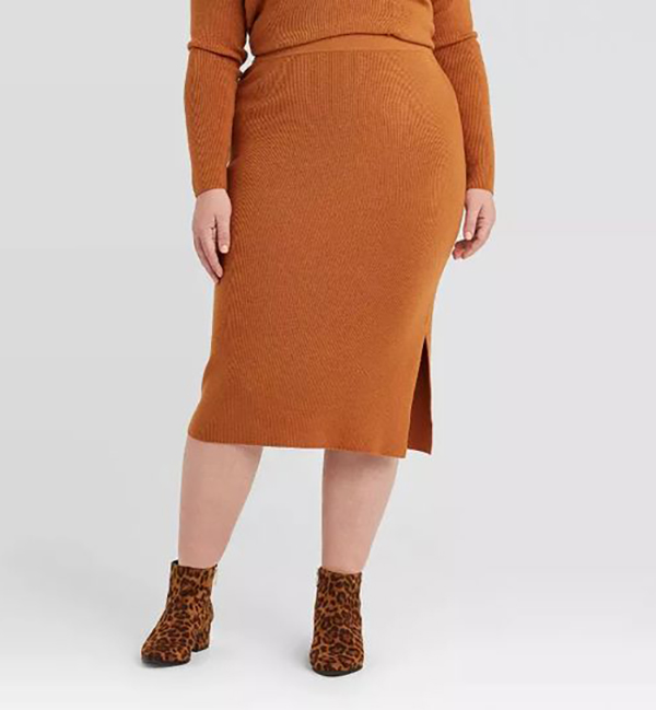 A plus-size model wearing a brown woven midi skirt.