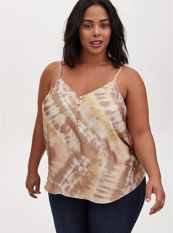 A plus-size model wearing a printed satin cami.