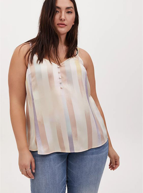 A plus-size model wearing a striped satin cami.