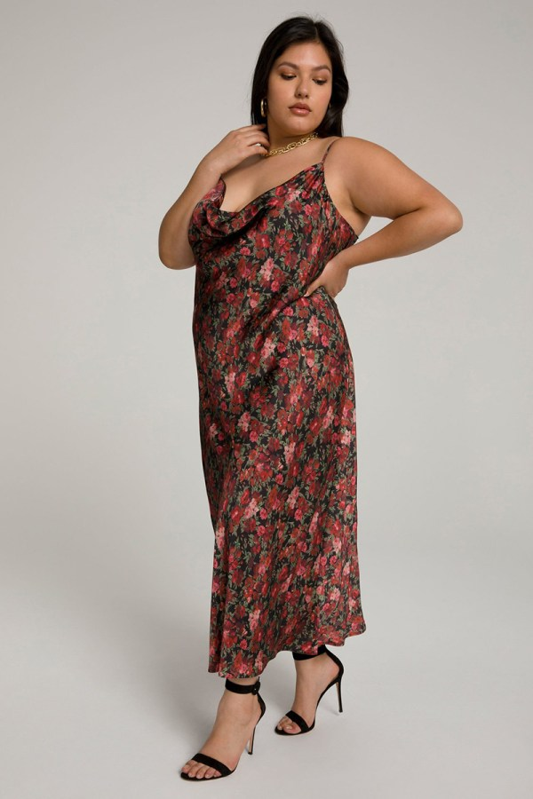 A plus-size model wearing a floral slip dress.