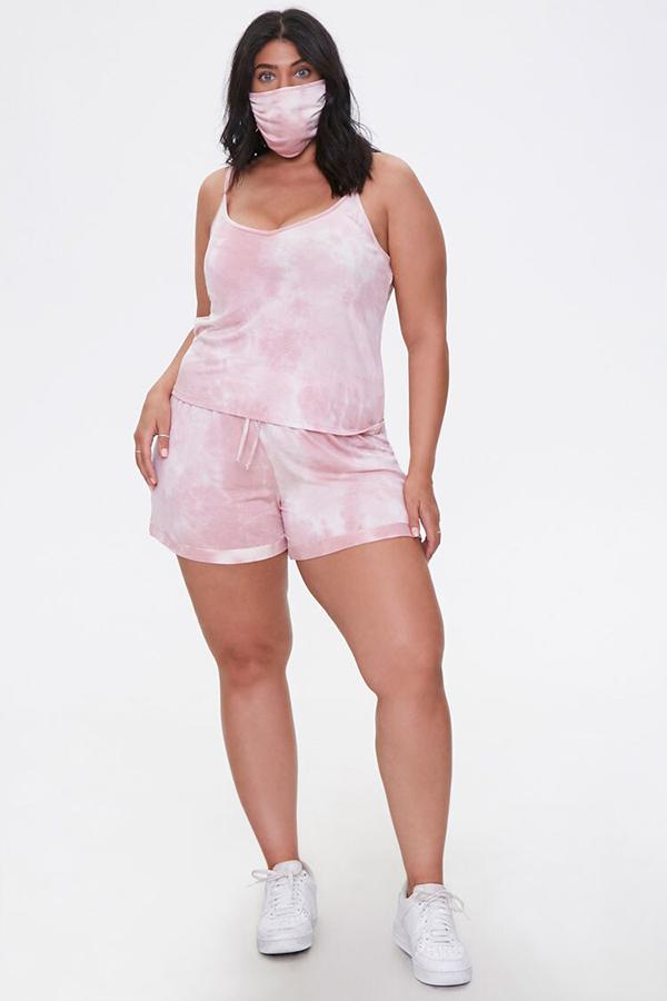 A plus-size model wearing a pink tie-dye lounge set.