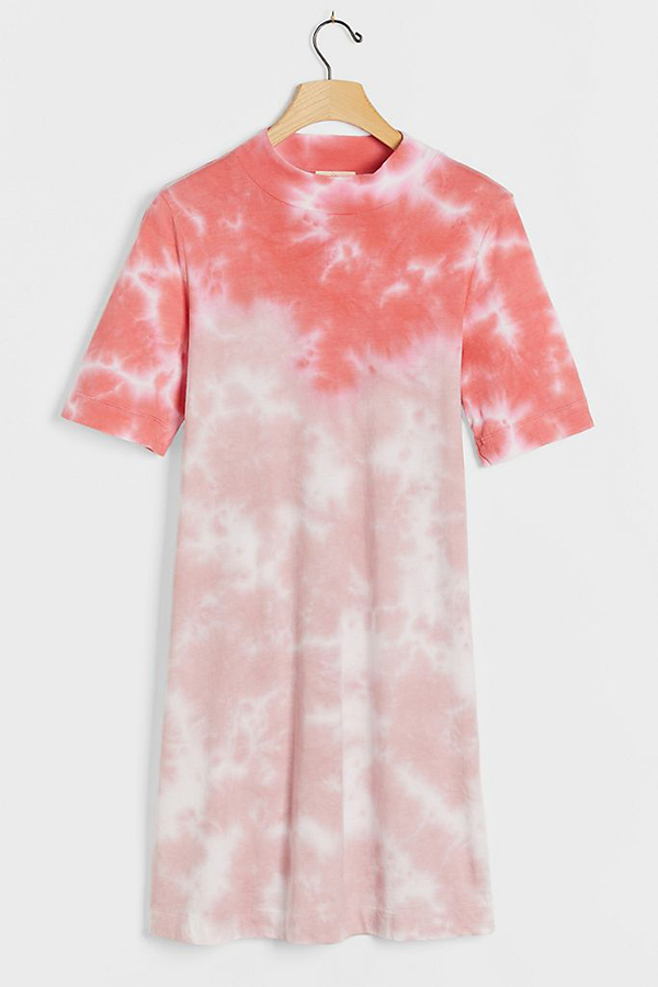 A plus-size coral tie-dye T-shirt dress.