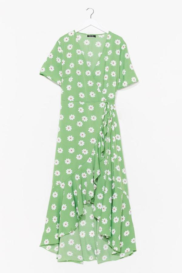 A plus-size green floral wrap dress.