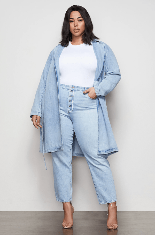 A plus-size model wearing a denim trench coat.