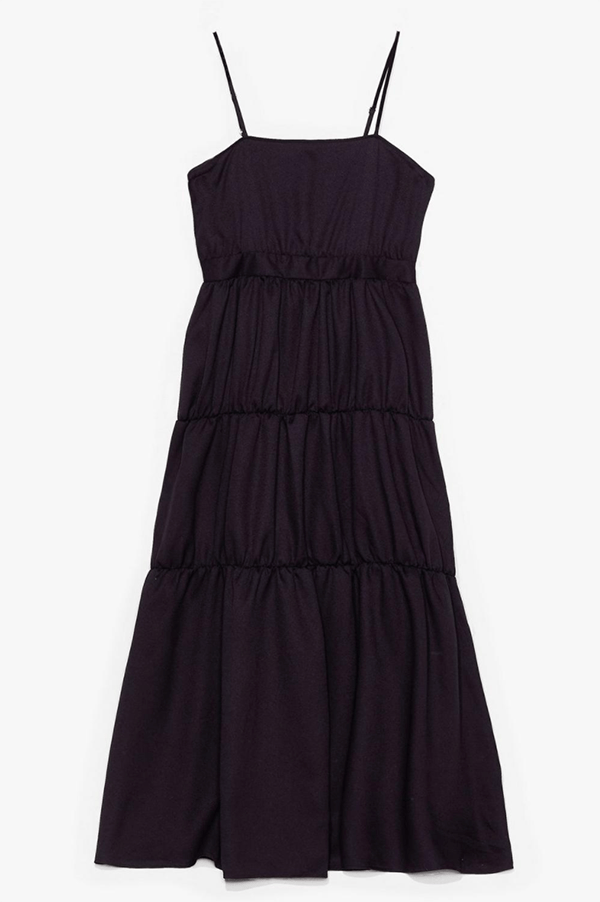 A plus-size black tiered maxi dress.