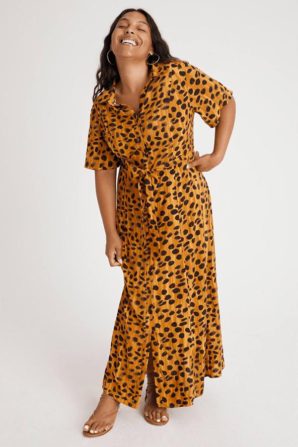 A plus-size model wearing a printed fall maxi dress.