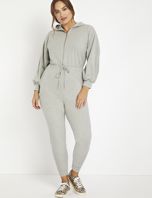 A plus-size model wearing a gray lounge jumpsuit.