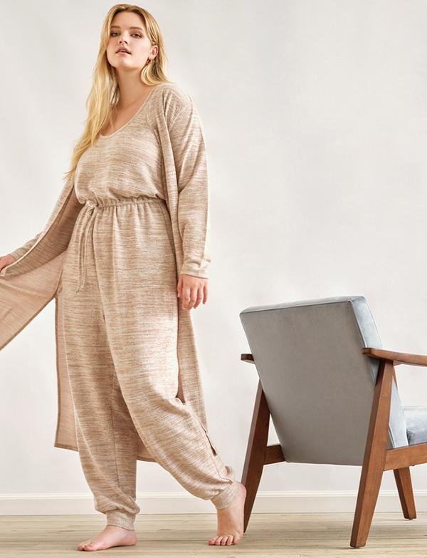 A plus-size model wearing an oatmeal maxi cardigan.