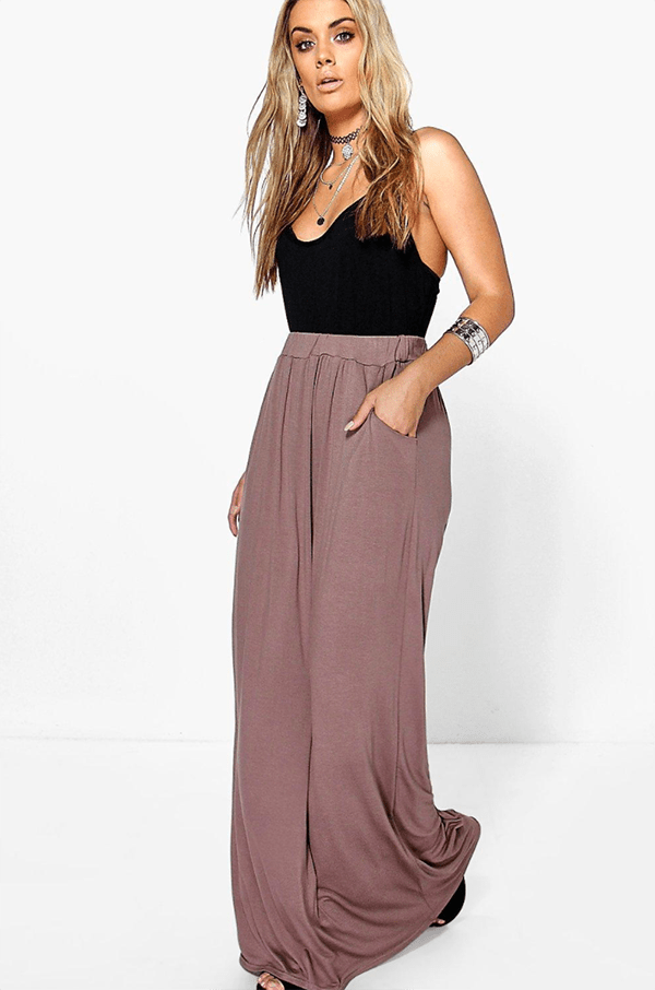 A plus-size model wearing a taupe maxi skirt.