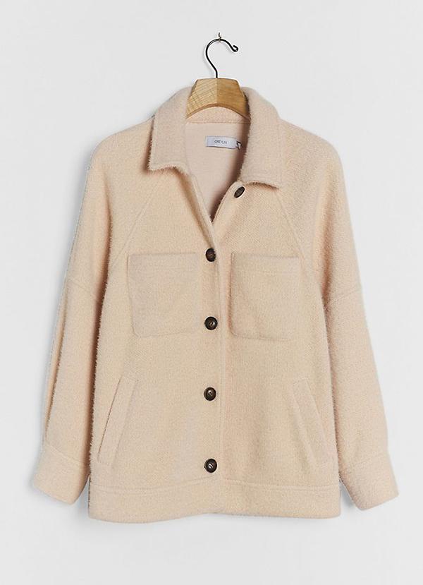 A plus-size off-white shirt jacket.