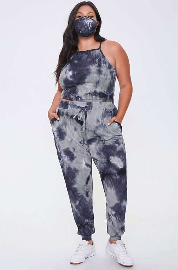 A plus-size model wearing gray tie-dye sweatpants.