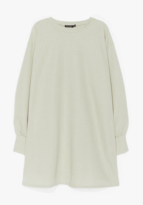 A plus-size light green sweatshirt dress.