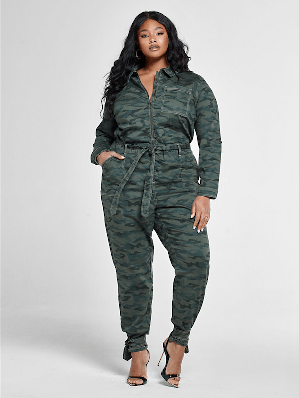 A model wearing a plus-size utility jumpsuit in camo.